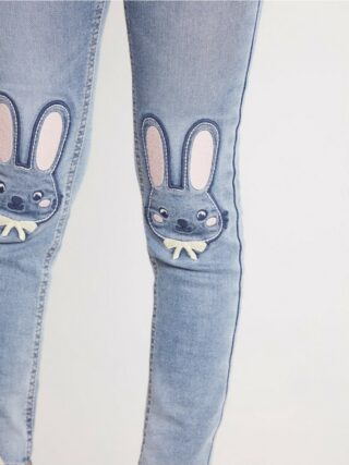 Slim fit jeans with rabbits